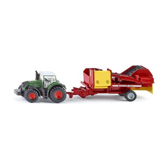Traktor kartulikombainiga